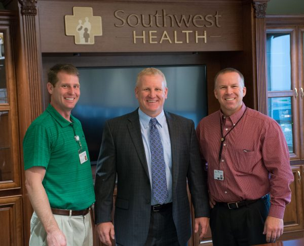 Brad Vamstad, The Orthopedic Institute at Southwest Health Director of Athletic Training and Sports Performance; Luke Francois, Mineral Point School District Superintendent; and Southwest Health CEO Dan Rohrbach pose for photo at the time of donation to the Mineral Point Stadium Project.