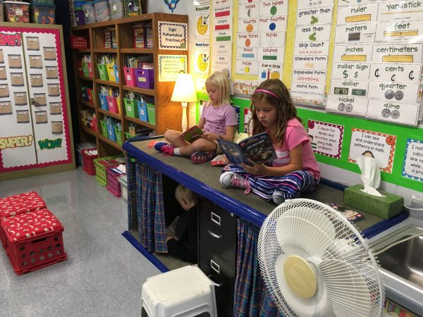 These 2nd graders have many options for reading locations.